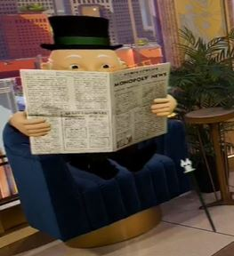Monopoly Man reading a newspaper